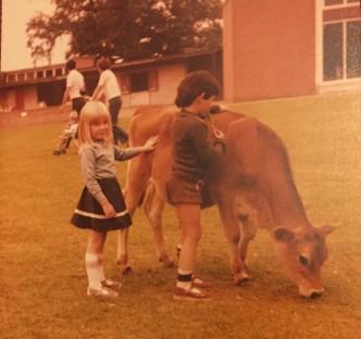Rebecca petting a cow